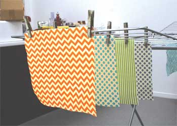 Beeswax wraps drying on clothes horse