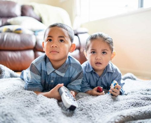 Little boy and girl watching TV