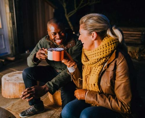 Healthy man and woman drinking tea in their 40s