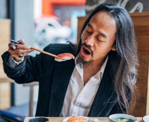 Man eating salmon nigiri