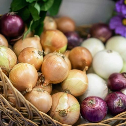 Basket full of diffrent types of onion