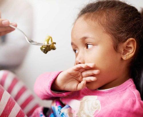 Little girl refusing food