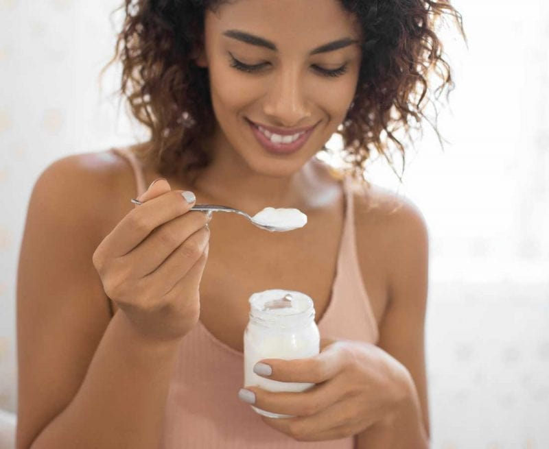 Woman eating yoghurt