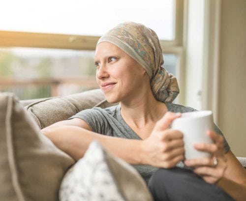 Woman cancer patient with scarf on head
