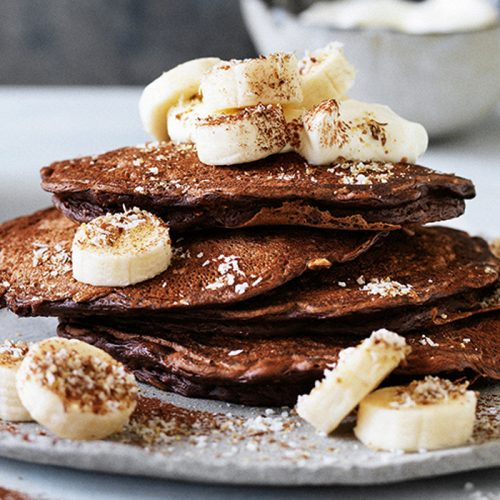 Chocolate pancakes with coconut and bananas