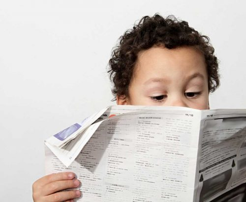 Kid reading the paper