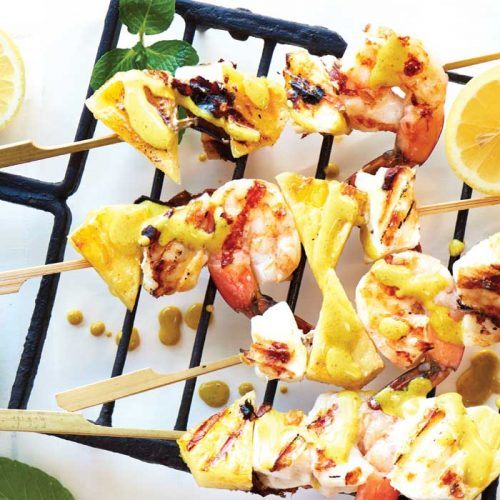 Seafood and pineapple skewers with coconut-curry sauce