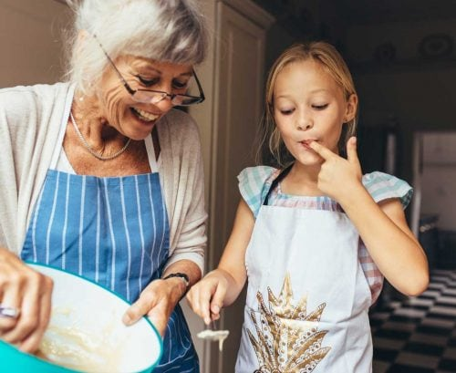 Grandmother cooking with grand daughter