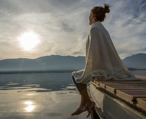 Woman looking into distance over a lake
