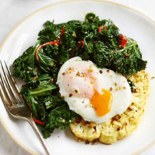 Poached eggs with cauliflower toasts, kale and dukkah