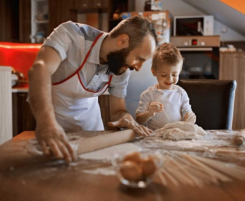 Father and son baking bread