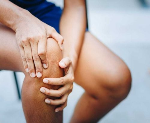 Man holding his sore knee