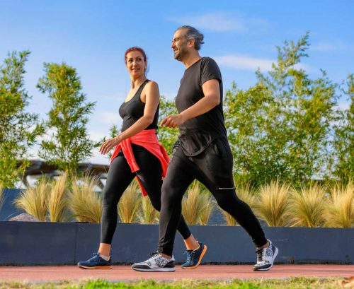 Man and woman walking for exercise