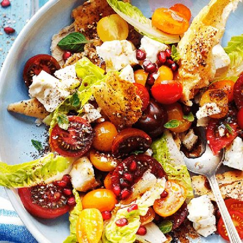 Mixed tomato and feta fatoush salad with za'atar and pomegranate