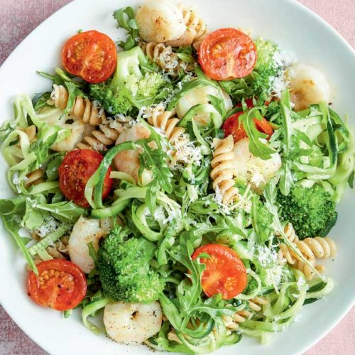 Pasta with garlicky prawns, wilted tomatoes and greens