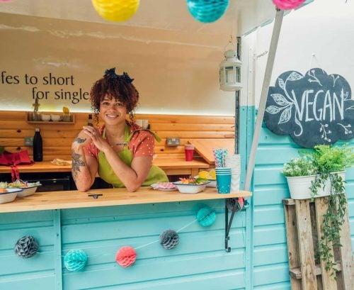 Smiling woman in a vegan food truck