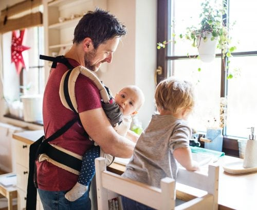 Man with baby and child doing the dishes