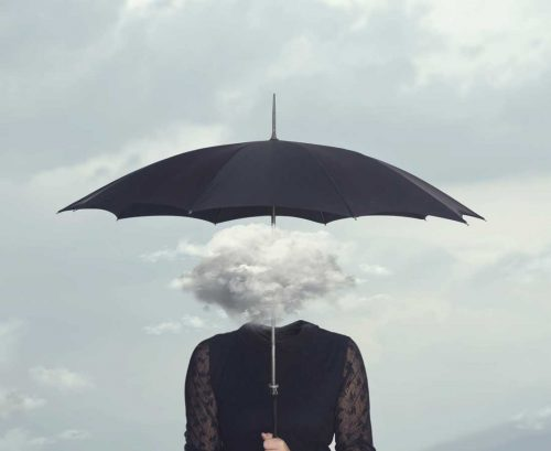 Woman with cloud for a head holding an umbrella
