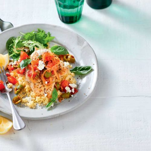 Oregano chicken with warm tomato and olive salsa