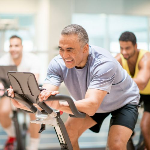 Man on stationary bike in spin class