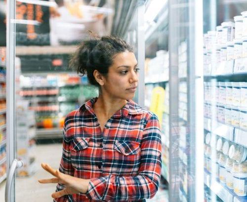 Woman shopping for yoghurt