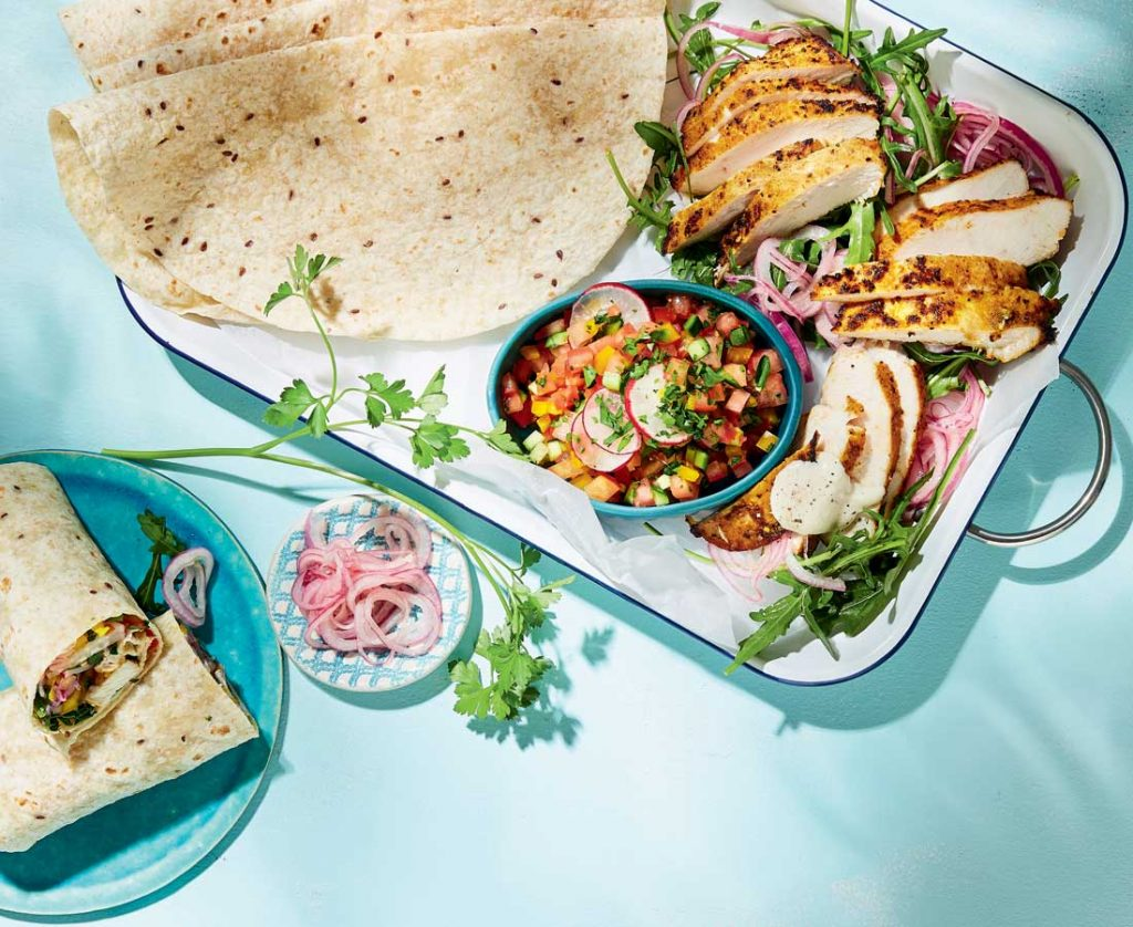 Chicken shawarma wraps with quick pickled onions and tahini sauce