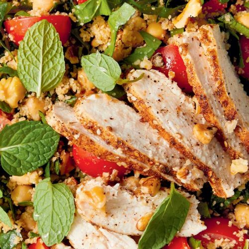 Spice-crusted chicken on chickpea and walnut salad