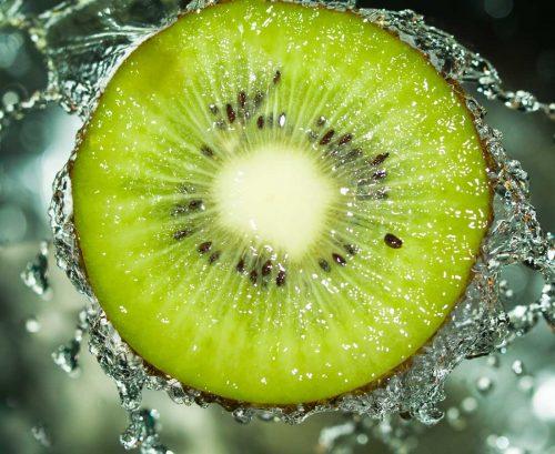 Green kiwifruit halved