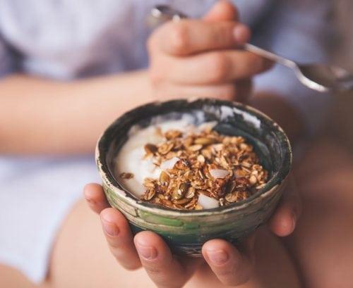 Woman eating toasted oats/muesli