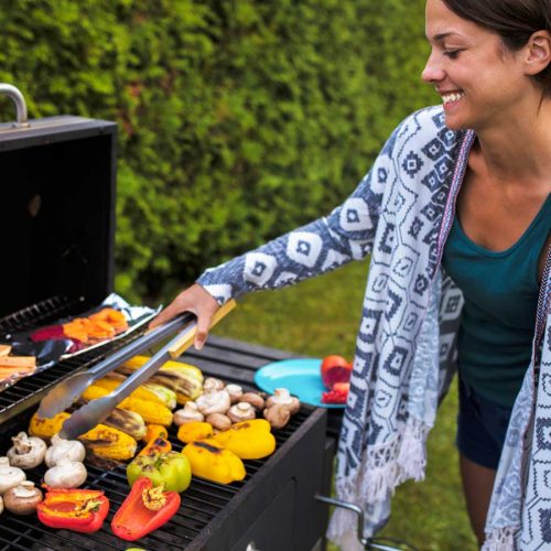 Woman barbecuing vegetables