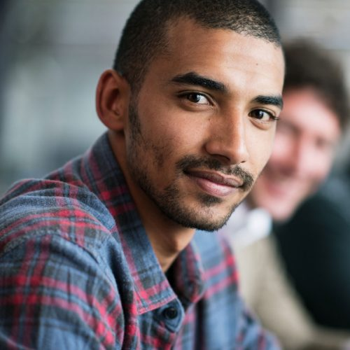 Young man looking directly into camera