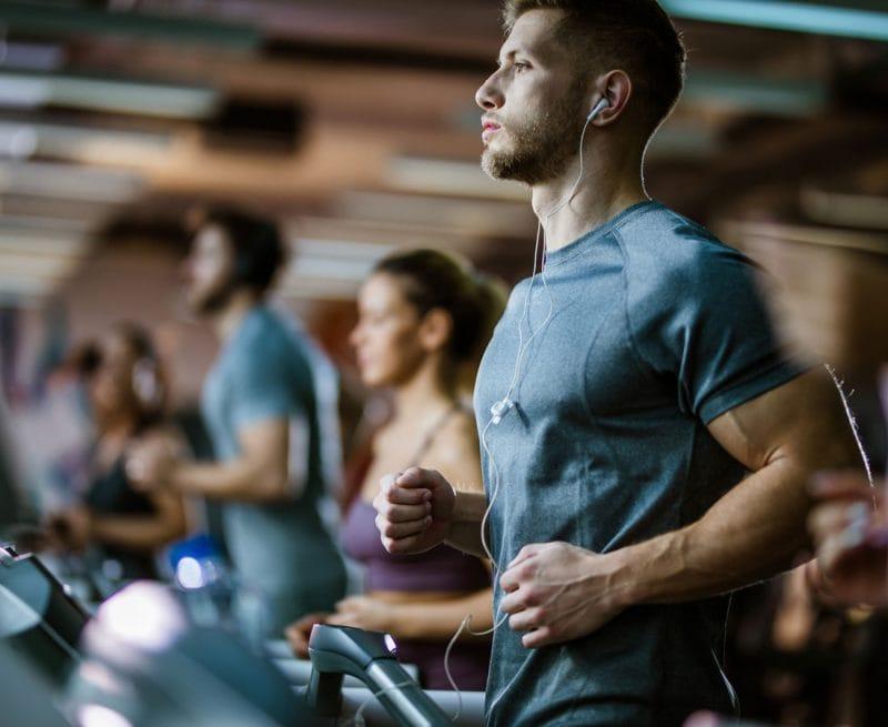 Man on treadmill at gym