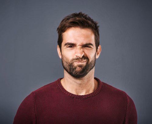 Man pulling a 'yuck' face