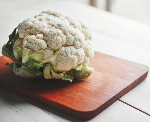 Head of cauliflower on a board