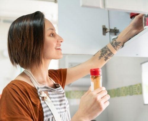 Woman looking in her kitchen cupboard