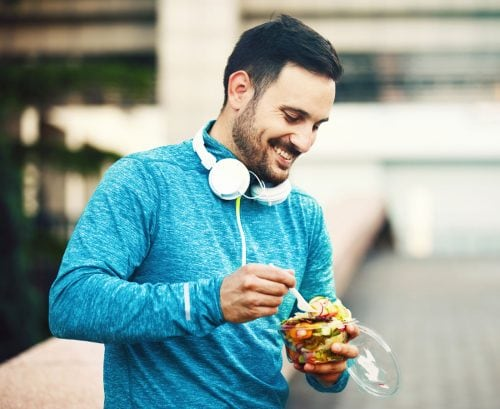 Man eating a salad breaking his fast