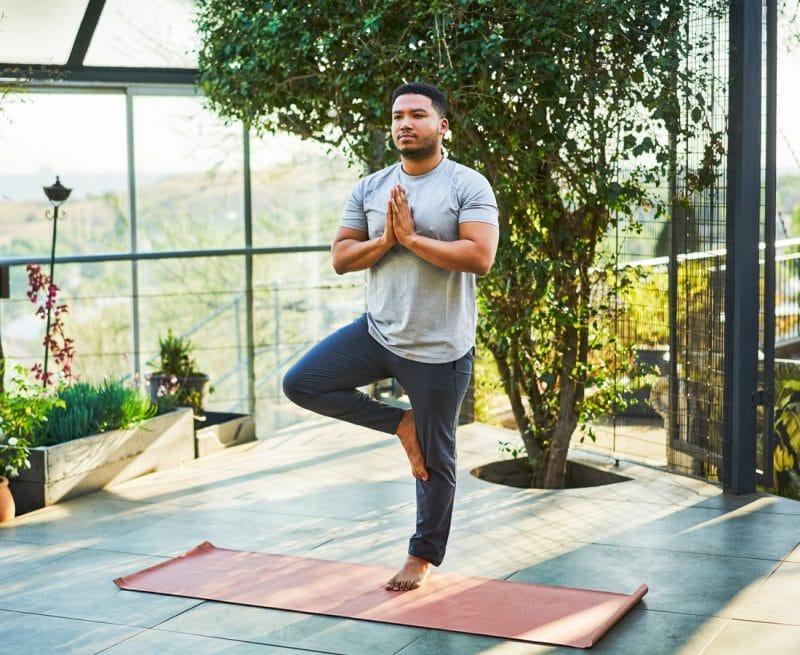 Man balancing on one leg doing yoga